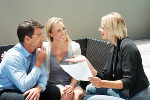 Agent explaning an investment scheme to a couple
